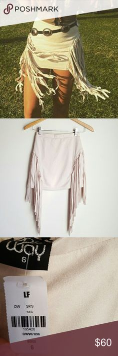 Nwt LF fringed high waisted faux suede mini skirt New with tags   LF Stores faux suede fringed bodycon stretchy high waisted skirt. Size 6 (small). Ivory combo.  Soft feel and just perfect! Fringe at sides make your waist look teeny teeny ?  Looks perfect paired with booties. A must for any bohemian closet :)  - No trades  - Price firm, unless bundled **  #lfstores #nastygal #topshop #dollskill #unif #free # people  #aa #brandy #reformation #lemons #alternative #apparel #hippie #bohemian…
