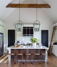 Barnboard, exposed beams, and ladder give character to this kitchen