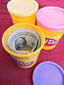 """Creative Way to Give Money #2: Play """"Dough  creative ways to give money  Reuse a Play-Doh container to hide money in as a gift.  This gift idea works great as a stocking stuffer!  Add a gift tag that says something like, """"Here's some 'dough' to play with this Christmas."""""""