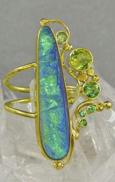 Jennifer Kalled, Boulder opal ring with peridot, & tsavorite garnet accents. In 22k and 18k gold. Boulder opals from Bill Kasso. www.kalledjewelrystudio.com