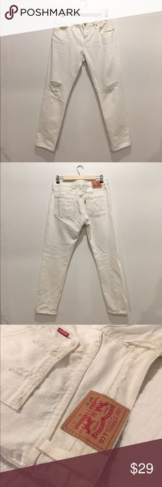 Levis 501 ct jeans white distressed The most essential white Levis 501 ct jeans  Distressed throughout mostly at the knees  100% cotton  Great quality not see through at all  Label size 27 these run large, best fit a size 28 Mid-rise with the classic button fly  Leg length 32in  Great condition 💯 Levi's Jeans Straight Leg