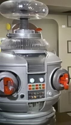 Cropped original image depicting the Robot from the 1960's Irwin Allen television series, LOST IN SPACE (original vintage image exposure levels and color adjusted for accuracy/clarity by RRM).