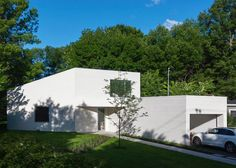 Jean Verville completes white-washed clapboard house in Montreal