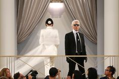 Paris, France      German designer Karl Lagerfeld appears at the end of his Haute Couture Fall Winter 2015/2016 fashion show for French fashion house Chanel at the Grand Palais on July 7.
