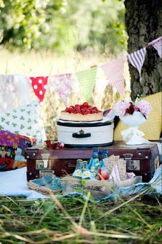 An old trunk is the perfect item to carry picnic items in, then use as a makeshift table. It's charming and functional.
