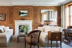 This Manhattan living room had faux-bois-painted walls when Mariette and Brooke began their 2006 design. The duo insisted on keeping the patterning and tracked down the original French artist to restore the work. They selected vanilla upholstery and English and French antiques in similar wood tones to complement the walls. Photo by Scott Frances