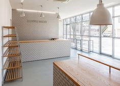 Renovated Japanese bakery featuring tiled walls and oak shelving.