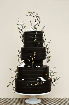 Chocolate brown cake with scattered love birds and floral decorations- cake design by by Art and Appetite.