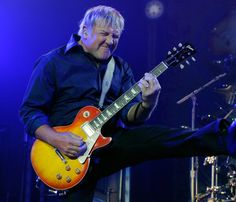 Alex Lifeson Photos - Rush guitarist Alex Lifeson performs at the MGM Grand Garden Arena during a stop of the band's Time Machine Tour August 14, 2010 in Las Vegas, Nevada. - Rush Time Machine Tour At The MGM Grand Garden Arena