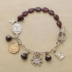 """CANTERBURY BRACELET Devotional medallions of old are reproduced in sterling silver and brass joined by black sapphires and garnets. Toggle clasp. A handcrafted exclusive. 7-1/2""""L."""