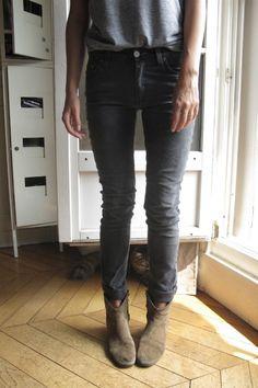 gray tee, black jeans, booties.