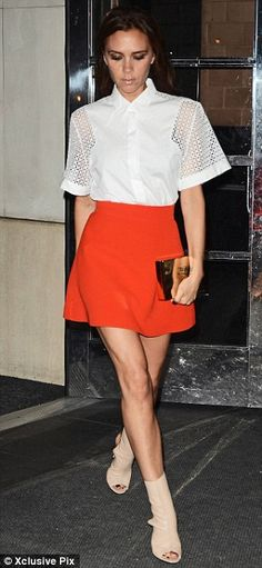 Accessory queen: Victoria teamed the skirt with a white shirt and tan heels