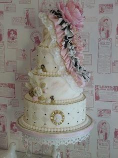 Pink, gold and black vintage inspired wedding cake