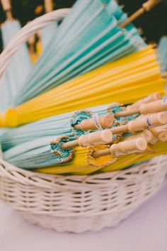 assortment of parasols in mint and yellow /  / http://www.himisspuff.com/mint-and-yellow-wedding-ideas/5/