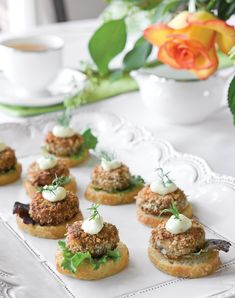 Lemon juice and dill provide subtle complements to the mild taste of salmon. Coated in bread crumbs and fried in hot oil, our Mini Salmon Croquette Canapés have a pleasing crunch atop French-bread crostini. Tea Time Snacks, Ideas Para Canapés, Tee Sandwiches, Yorkshire, High Tea Food, Canapes Recipes, Salmon Croquettes, Afternoon Tea Recipes, Brunch
