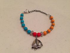 Sailboat charm bracelet - yellow, turquoise and red glass beads - silver accent beads - lobster clasp closure  on Etsy, $16.00