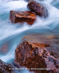 A long shutter-speed softens the water in Moraine Creek in Banff National Park in Alberta, Canada. ©Ric Ergenbright