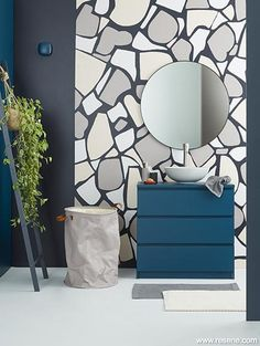 An in demand finish in the 1950s and '60s, terrazzo is a trend that has resurfaced once again. Back wall in Resene Jaguar with painted terrazzo in Resene Alpaca, Resene Urbane and Resene Tom Tom, Left wall in Resene Tangaroa, Right wall in Resene High Tide, Floor in Resene Mercury, Vanity in Resene Tangaroa, Ladder in Resene High Tide, Hooks in Resene Tangaroa (left) and Resene Alpaca (right), Soap dispenser in Resene Tom Tom. Resene Colours, Stone Accent Walls, Terrazzo Tile, Tiles, Freedom Furniture, Color Inspiration, Wall Decor, Interior Design, High Tide