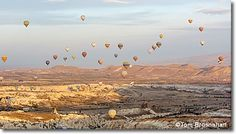 Cappadocia, Turkey  Take in breathtaking sights of natural fairy chimney rock formations (hoodoos), panoramic vistas, and the picture-perfect image of vibrant hot-air balloons—all the while experiencing flying high in the sky—in the semi-arid town of Cappadocia, Turkey.
