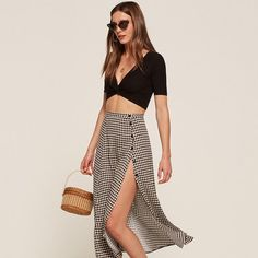 A side slit midi skirt in black gingham.