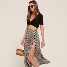 A side slit midi skirt in black gingham.