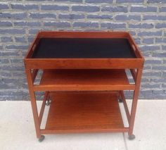 This functional and super stylish Danish mid-century modern serving cart sits on caster wheels, making it convenient when hosting…
