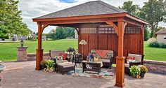 """Traditional"" wood pavilion with Superior posts and privacy panel"