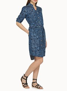 Exclusively from Contemporaine     This season's trendy piece in ultra light and fluid faux denim   Blouse design with full-length buttons and a matching tie belt accent   Roll tab sleeves   Two patch pockets on the chest and vertical pockets hidden in the seams    The model is wearing size 4