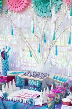This marvelous DISNEY'S FROZEN THEMED BIRTHDAY PARTY was submitted by Cris McGrath of Crissy's Crafts. What a cute winter birthday party theme! I absolutely adore all of the cute dessert ideas such as the blue rock candy sugar sticks hanging from the tree like icicles and the ice cream blizzards!