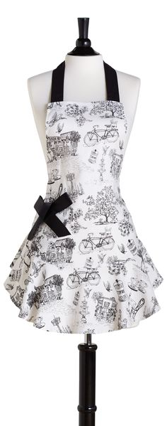 With its flirty ruffle hem and pocket bow detail the feminine Josephine is perfect for today's hostess. Cafe Toile print draws its inspiration from a chic Parisian cafe and is made from fine, light-we