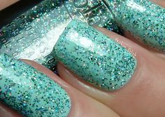 Beyond the Mistletoe  (over Essie Mint Candy Apple)  green, silver and holographic glitter