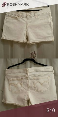 Levi shorts Low-rise white levi shorts only wore them one time perfect for that Fourth of July picnic, if you are seeing a pink tint to these shorts there is none it's just my camera Levi's Shorts Jean Shorts