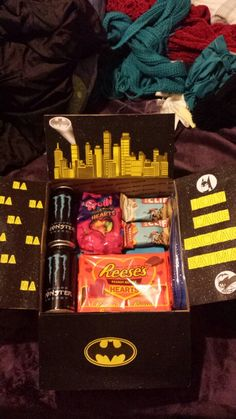 Batman care package for my marine :) hope he likes all this junk! There's like 8 more cans of Monsters under everything, this is actually like a day's worth for him
