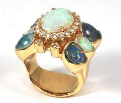 Custom made Yellow Gold & Diamond Opal Ring, made with our clients own Opals.  With our craftsmanship and our clients Opals, together this stunning Cocktail ring was created!