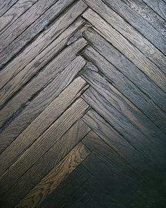 Dark wood floor in #herringbone