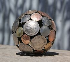 Turn Old Keys and Coins into Recycled Art: We have used countless house hold items in recycling art, and this time we are going to turn old keys and coins into Handmade Home Decor, Handmade Decorations, Travel Decorations, Garden Decorations, Penny Ball, Coin Crafts, Key Crafts, Foreign Coins, Coin Art