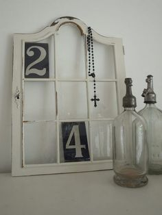 Love the numbers idea - Perfect for your lucky numbers, or first house street number as a momento (Could even take the numbers off your old letter box) - Cute! Empty Frames Decor, Old Frames, Vintage Windows, Old Windows, Antique Bottles, Vintage Bottles, Shabby Vintage, Shabby Chic, Window Pane Decor