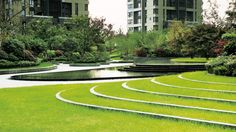 The apartment complex is set on a completely flat plain to the east of the Yangtze River, yet on a site too large to meaningfully respond to its riverland context. In landscaping the first phase of the development, comprising seven high-rise towers around a spacious central garden.