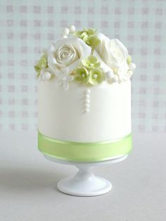 Small Green and White Cake.  So pretty.  Perhaps one like this for the cake cutting and coordinating cupcakes for the guests