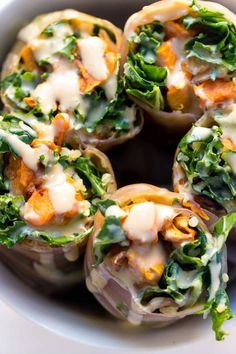 Seasonal Quinoa Spring Rolls made with roasted sweet potato, massaged kale salad, quinoa and wrapped in brown rice papers {vegan + gf}