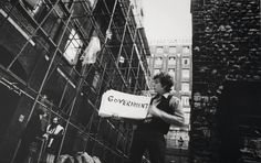 """© Tony Frank, 1965, Bob Dylan(video shoot for 'Subterranean Homesick Blues'), LondonShot in a nondescript alley behind the Savoy Hotel in London, the video for Bob Dylan's """"Subterranean Homesick Blues"""" served as the opening segment for Don't Look Back, D. A. Pennebaker's 1967 documentary of Dylan's first tour through England in 1965.Shot with a nod to the cinéma vérité style of the film, the famous clip shows Dylan hoisting more-or-less corresponding cue cards to his politicized lyric..."""