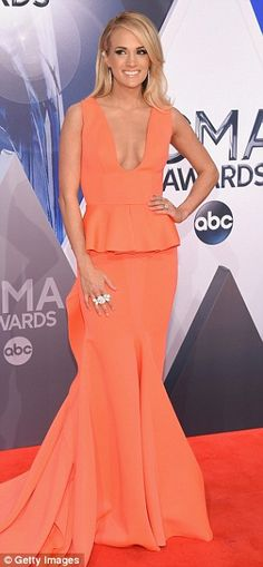 Blonde ambition: The beauty had on a plunging dress with a nice mermaid tail and accessori...