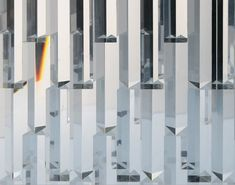 """This installation gives """"walking into the light"""" a whole new meaning. Japanese designer Tokujin Yoshioka will exhibit a glass window made of 500 crystal Modern Metropolis, Texture Art, Modern Lighting, Solar Panels, Wind Turbine, Designer, Stained Glass, Vibrant Colors, Rainbow"""