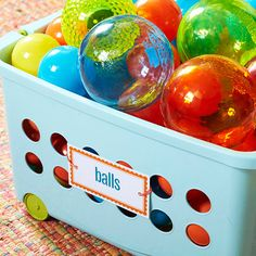 Play Bin- Toys clutter a room instantly. Keep labeled rolling bins in plain view. The kids will know where to put their toys when it's cleanup time. Print the labels on heavy cardstock or matte photo paper (laminate the labels for extra durability). Punch two holes in the labels and attach to bins with zip ties.
