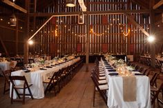 A more casual kings table for guest seating in the barn at Riverside on the Potomac. Photo: Zoeica Images. Wedding Coordination: Event Accomplished.
