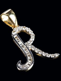 """Bewitching Diamond Pendent In The Shape Of """"r"""" Available In 14kt Gold."""