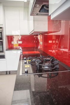 Red Ganesh Premium Collection Glass Kitchen Splashback By CreoGlass Design  (London,UK).