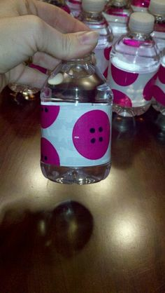 DIY mini bottle waters. I used polka dot duck tape and put black dots to look like buttons for a Lalaloopsy party