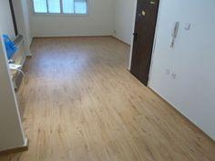 Living room with laminate floor  פרקטים למינציה בסלון  יורם פרקט מכירה והתקנה  טל: 050-9911998 http://www.2all.co.il/web/Sites1/yoram-parquet/PAGE17.asp