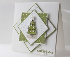 Handmade Christmas Card with lots of layers. Christmas tree with rhinestone ornaments.